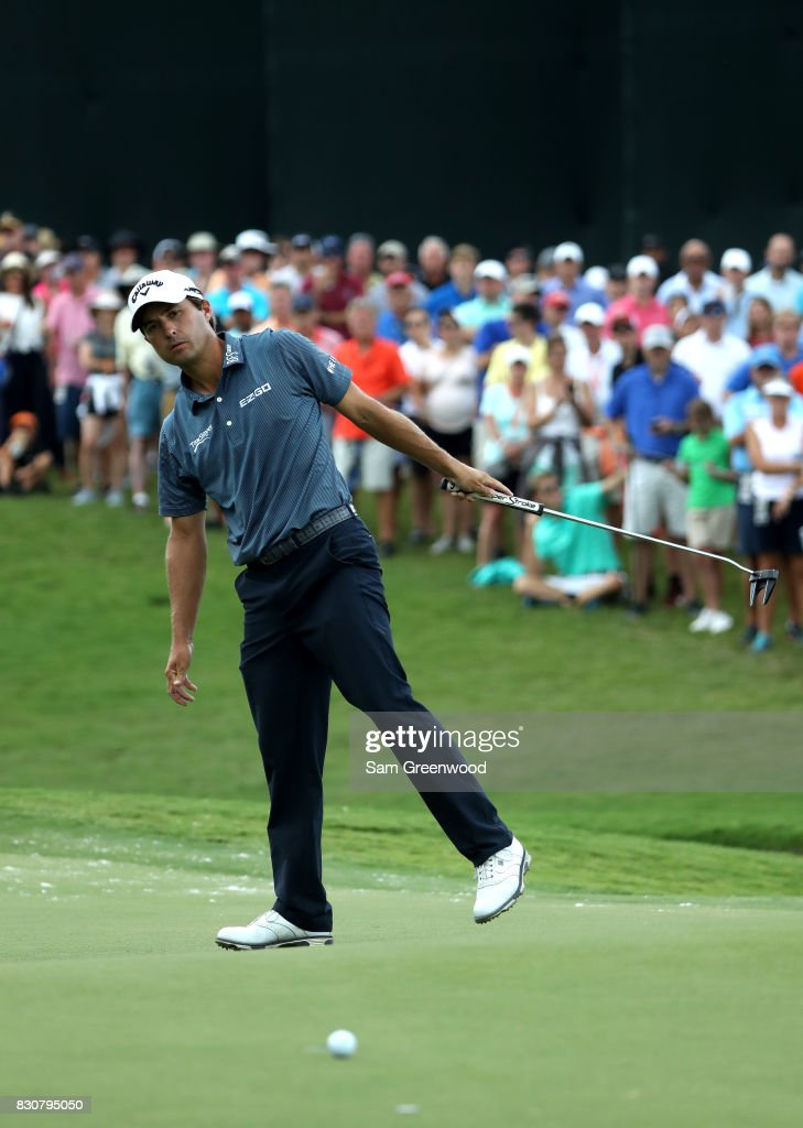Kevin Kisner of the United States reacts to his putt on the first green during the third round of the 2017 PGA Championship at Quail Hollow Club on August 12, 2017 in Charlotte, North Carolina.
