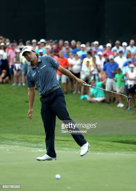 Kevin Kisner of the United States reacts to his putt on the first green during the third round of the 2017 PGA Championship at Quail Hollow Club on...