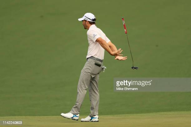Kevin Kisner of the United States reacts to his putt on the second green during the second round of the Masters at Augusta National Golf Club on...