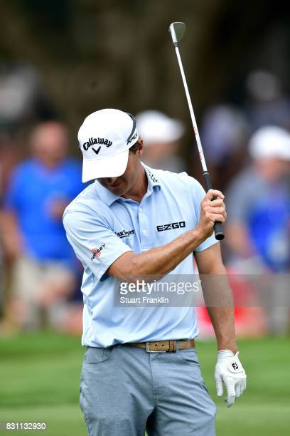 Kevin Kisner of the United States reacts to his shot on the tenth hole during the final round of the 2017 PGA Championship at Quail Hollow Club on...
