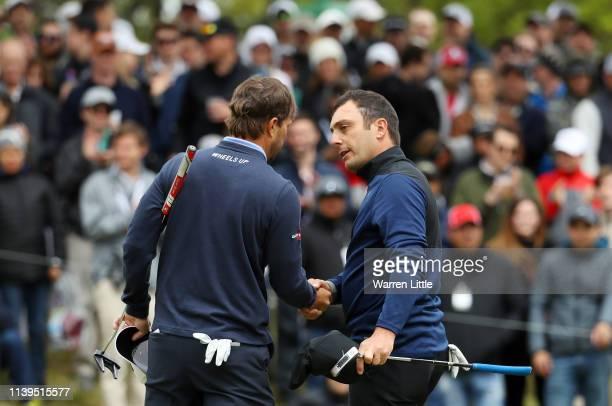 Kevin Kisner of the United States shakes hands with Francesco Molinari of Italy after defeating him 1up during the semifinal round of the World Golf...