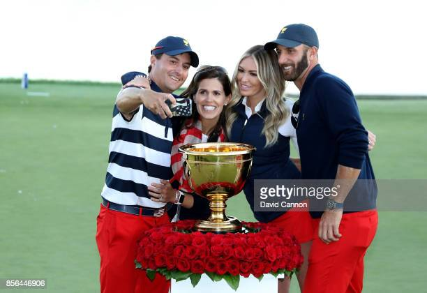 Kevin Kisner of the United states team takes a selfie with his wife Brittany Anne DeJarnett and Dustin Johnson and his fiancee Paulina Gretsky at the...