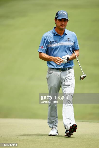 Kevin Kisner of the United States walks to the 18th green, the first-playoff hole in a six-way sudden-death playoff, during the final round of the...