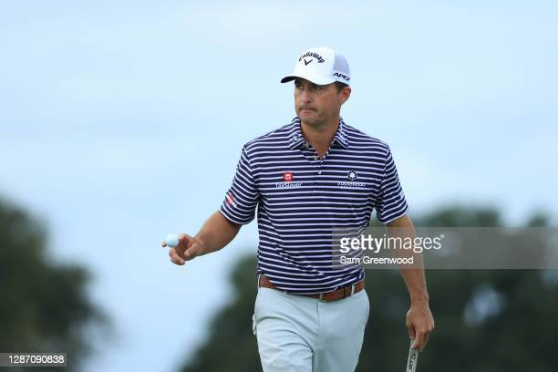 Kevin Kisner of the United States waves after making a birdie on the 15th hole during the final round of The RSM Classic at the Seaside Course at Sea...