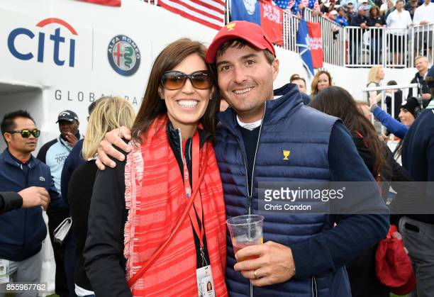 Kevin Kisner of the US Team and his wife Brittany Kisner on the first tee during the afternoon fourball matches at the Presidents Cup at Liberty...
