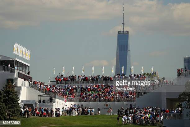 Kevin Kisner of the US Team plays a shot on the first tee during Friday fourball matches of the Presidents Cup at Liberty National Golf Club on...