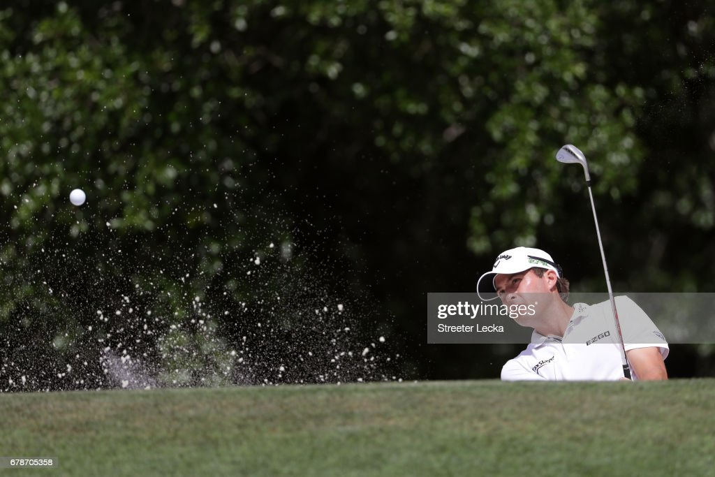 Kevin Kisner plays a shot from a bunker on the ninth hole during round one of the Wells Fargo Championship at Eagle Point Golf Club on May 4, 2017 in Wilmington, North Carolina.