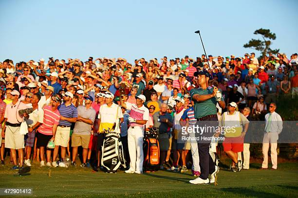 Kevin Kisner plays his shot from the 18th tee during a playoff in the final round of THE PLAYERS Championship at the TPC Sawgrass Stadium course on...