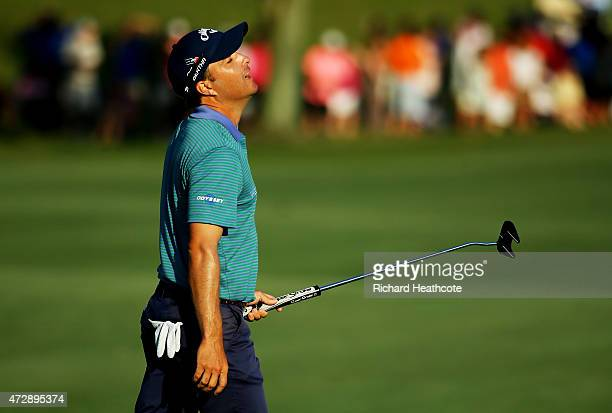 Kevin Kisner reacts on the 18th green during the final round of THE PLAYERS Championship at the TPC Sawgrass Stadium course on May 10 2015 in Ponte...