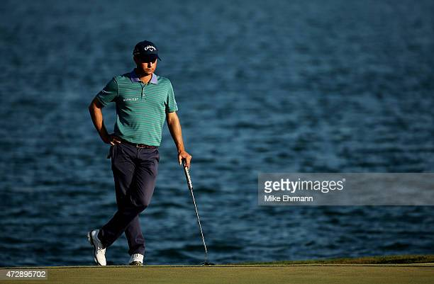 Kevin Kisner stands on the 18th green during the final round of THE PLAYERS Championship at the TPC Sawgrass Stadium course on May 10 2015 in Ponte...