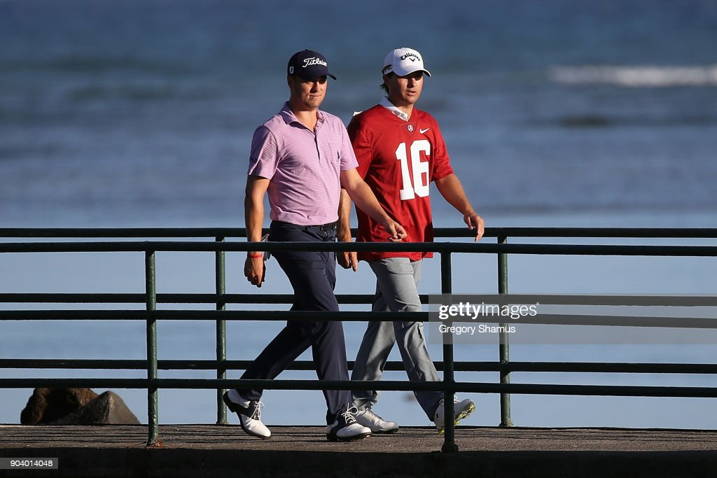 Kevin Kisner (R) wears a Alabama Crimson Tide football jersey after losing a bet to Justin Thomas (L) over the outcome of the 2018 College Football Playoff National Championship game during round one of the Sony Open In Hawaii at Waialae Country Club on January 11, 2018 in Honolulu, Hawaii.