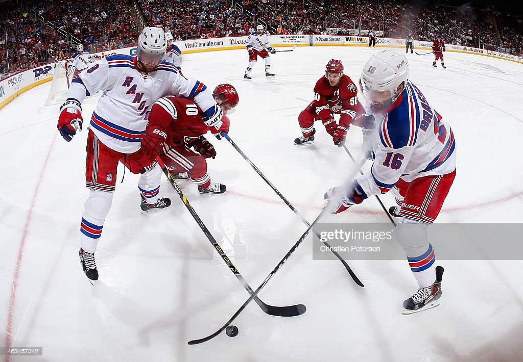 Kevin Klein #8 and Derick Brassard #16 of the New York Rangers control the puck under pressure from Martin Erat #10 and Antoine Vermette #50 of the Arizona Coyotes during the first period of the NHL game at Gila River Arena on February 14, 2015 in Glendale, Arizona.