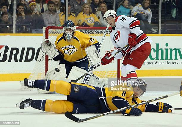 Kevin Klein and goaltender Marek Mazanec of the Nashville Predators look to block a shot by Riley Nash of the Carolina Hurricanes as Elias Lindholm...