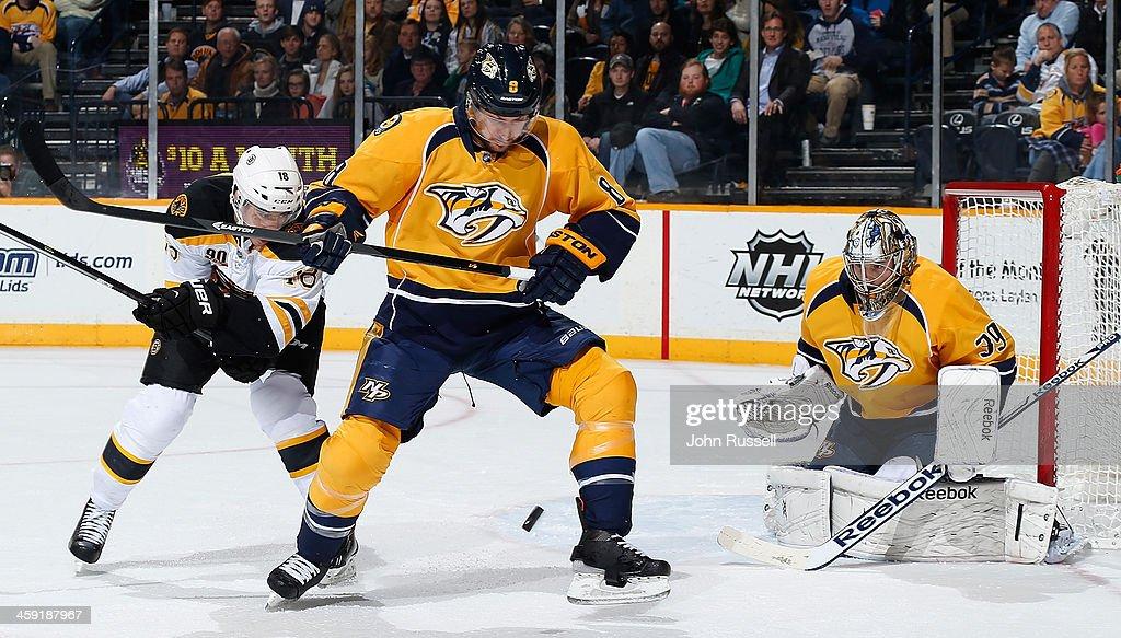 Kevin Klein #8 of the Nashville Predators blocks a shot in front of Predators goalie Marek Mazanec #39 against the Boston Bruins at Bridgestone Arena on December 23, 2013 in Nashville, Tennessee.