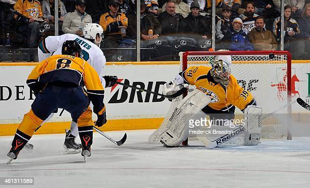 Kevin Klein of the Nashville Predators watches as Eriah Hayes of the San Jose Sharks hits the post to the left of Predators goalie Marek Mazanec at...