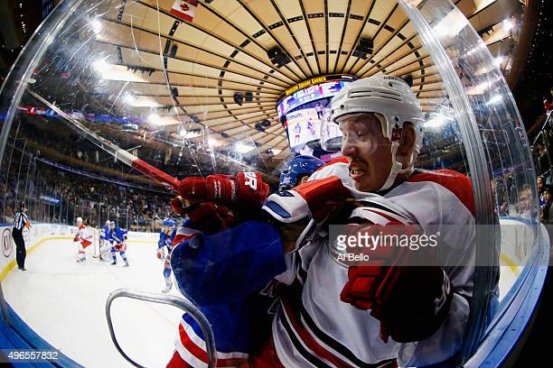 Kevin Klein of the New York Rangers checks Joakim Nordstrom of the Carolina Hurricanes during their game at Madison Square Garden on November 10 2015...