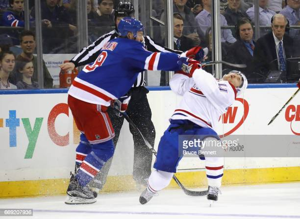 Kevin Klein of the New York Rangers hits Brendan Gallagher of the Montreal Canadiens during the first period in Game Three of the Eastern Conference...