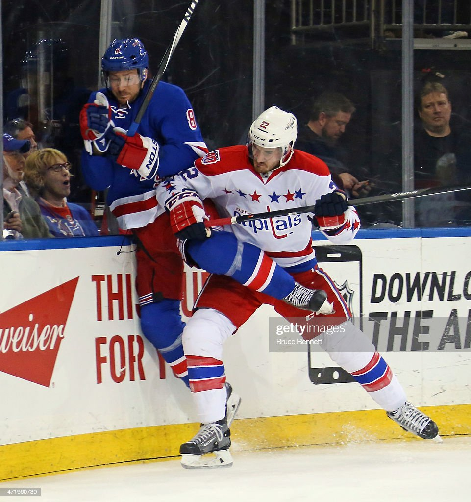 Kevin Klein #8 of the New York Rangers is hit into the end boards by Curtis Glencross #22 of the Washington Capitals during the first period in Game Two of the Eastern Conference Semifinals during the 2015 NHL Stanley Cup Playoffs at Madison Square Garden on May 2, 2015 in New York City.