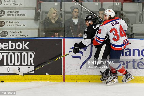 Kevin Klima of the Moncton Wildcats checks Pascal Corbeil of the Blainville-Boisbriand Armada during the QMJHL game at the Centre d'Excellence Sports...