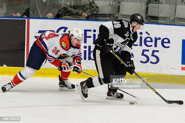 Kevin Klima of the Moncton Wildcats defends the puck against Miguel Picard of the Blainville-Boisbriand Armada during the QMJHL game at the Centre...