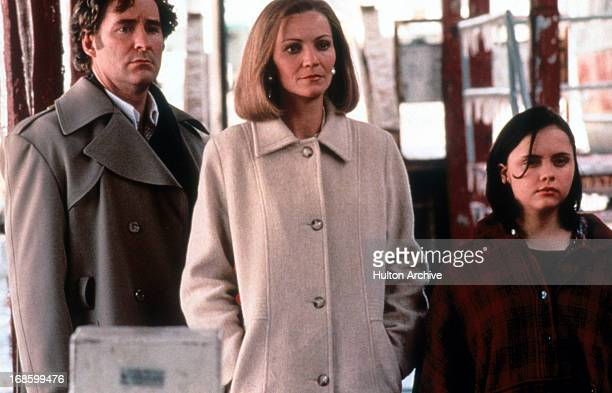 Kevin Kline Joan Allen and Christina Ricci all standing on a sidewalk wearing coats and staring in the same direction in a scene from the film 'The...