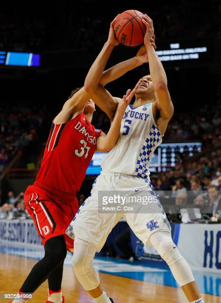 Kevin Knox of the Kentucky Wildcats and Kellan Grady of the Davidson Wildcats battle for the ball in the second half during the first round of the...