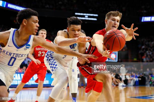 Kevin Knox of the Kentucky Wildcats and Oskar Michelsen of the Davidson Wildcats battle for the ball in the second half during the first round of the...