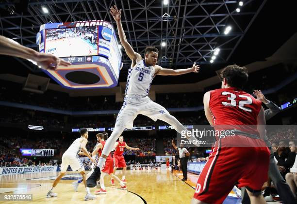 Kevin Knox of the Kentucky Wildcats defends an inbounds pass by Rusty Reigel of the Davidson Wildcats in the first half during the first round of the...