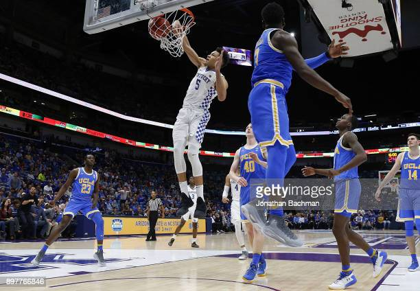 Kevin Knox of the Kentucky Wildcats dunks the ball against Aaron Holiday of the UCLA Bruins during the second half of the CBS Sports Classic at the...