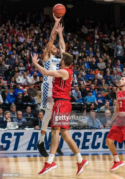 Kevin Knox of the Kentucky Wildcats shoots over F Peyton Aldridge of the Davidson Wildcats during the NCAA Division I Men's Championship First Round...
