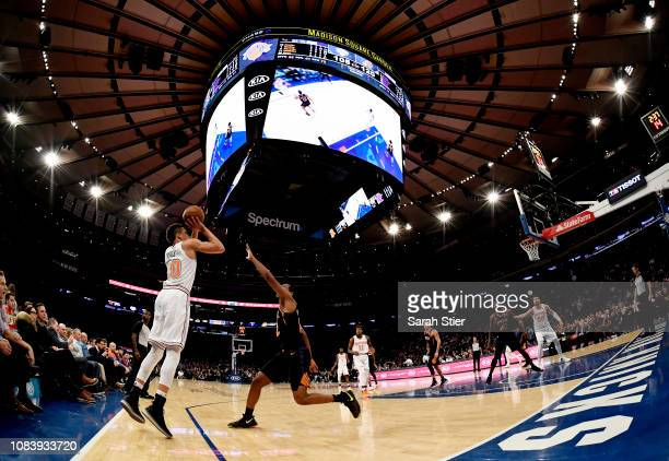 Kevin Knox of the New York Knicks attempts a basket during the fourth quarter of the game against the Phoenix Suns at Madison Square Garden on...