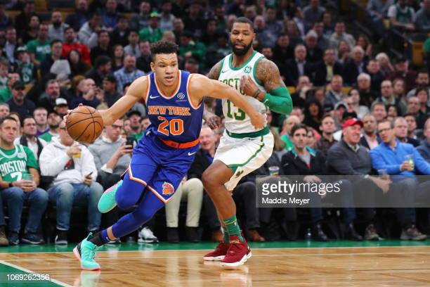 Kevin Knox of the New York Knicks dribbles past Marcus Morris of the Boston Celtics during the game between the Boston Celtics and the New York...