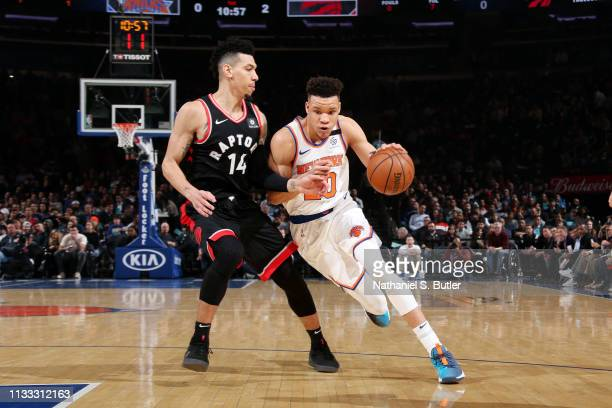 Kevin Knox of the New York Knicks handles the ball against Danny Green of the Toronto Raptors on March 28 2019 at Madison Square Garden in New York...