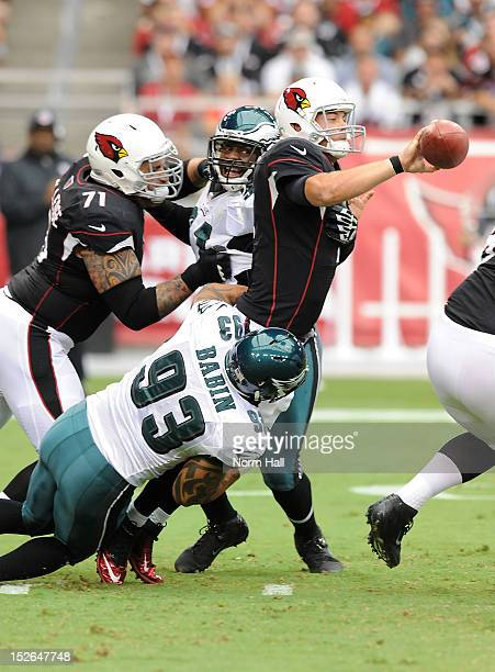 Kevin Kolb of the Arizona Cardinals gets rid of the ball just before being sacked by Jason Babin of the Philadelphia Eagles at University of Phoenix...