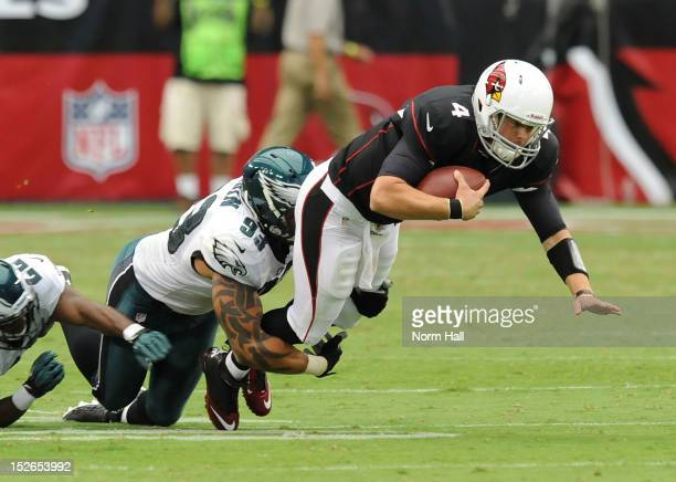 Kevin Kolb of the Arizona Cardinals is tackled by Jason Babin of the Philadelphia Eagles at University of Phoenix Stadium on September 23 2012 in...