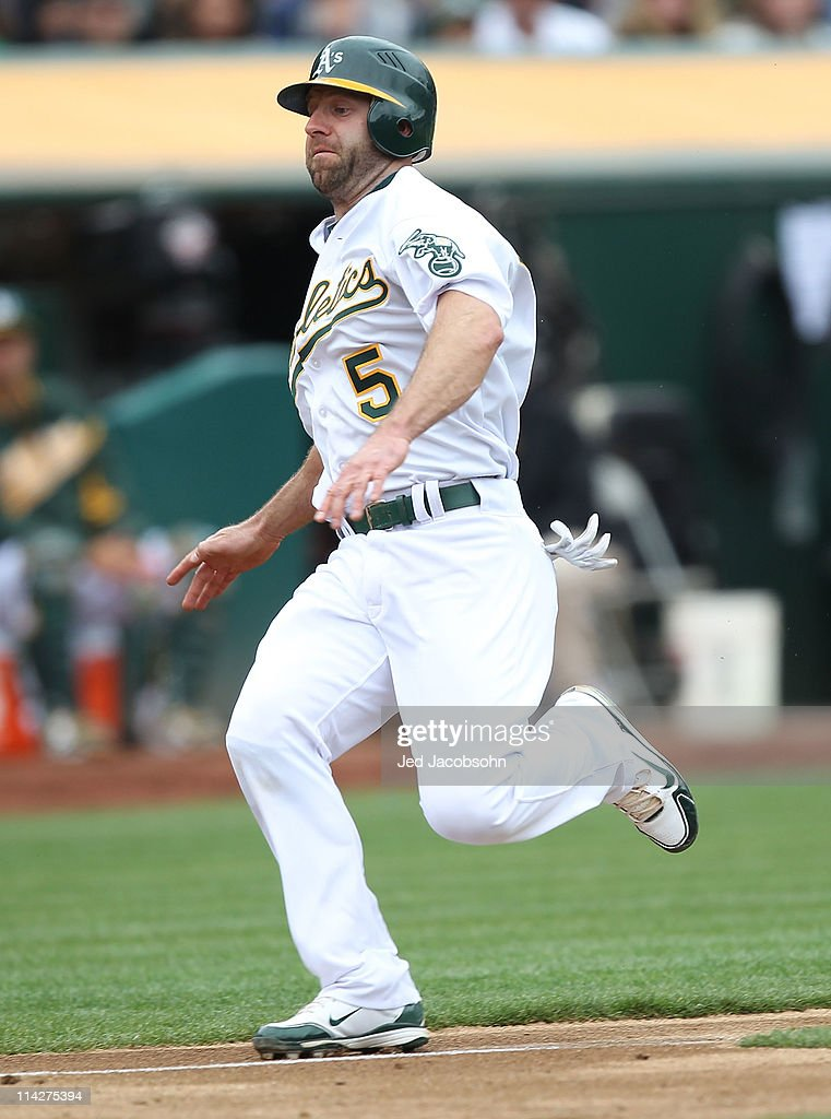 Kevin Kouzmanoff #5 of the Oakland Athletics runs to home against the Chicago White Sox during a Major League Baseball game at the Oakland-Alameda County Coliseum on May 14, 2011 in Oakland, California.