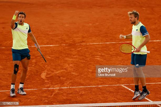 Kevin Krawietz and Andreas Mies of Germany celebrate a point in their Men's Doubles Final on Court Philippe-Chatrier against Mate Pavic of Croatia...