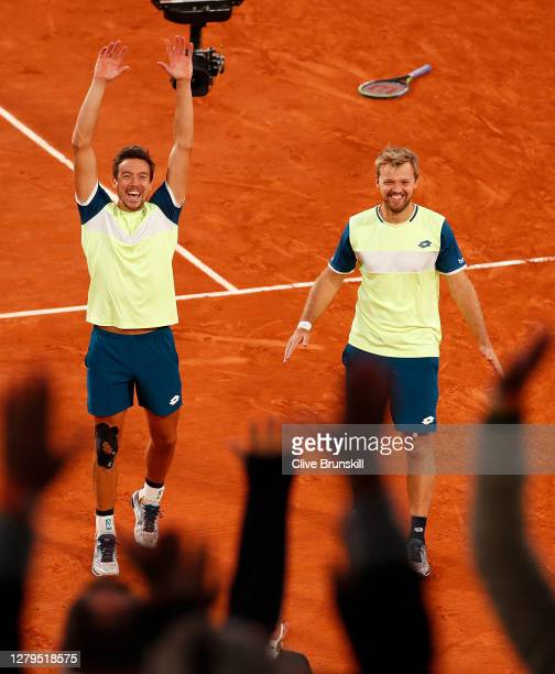 Kevin Krawietz and Andreas Mies of Germany celebrate after winning championship point in their Men's Doubles Final on Court Philippe-Chatrier against...