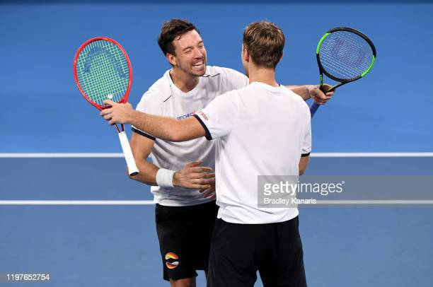 Kevin Krawietz and Andreas Mies of Germany celebrate victory in their doubles match against Michail Pervolarakis and Stefanos Tsitsipas of Greece...