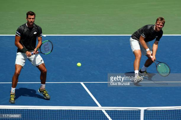 Kevin Krawietz and Andreas Mies of Germany in action during their Men's Doubles second round match against Martin Damm and Toby Alex Kodat of the...