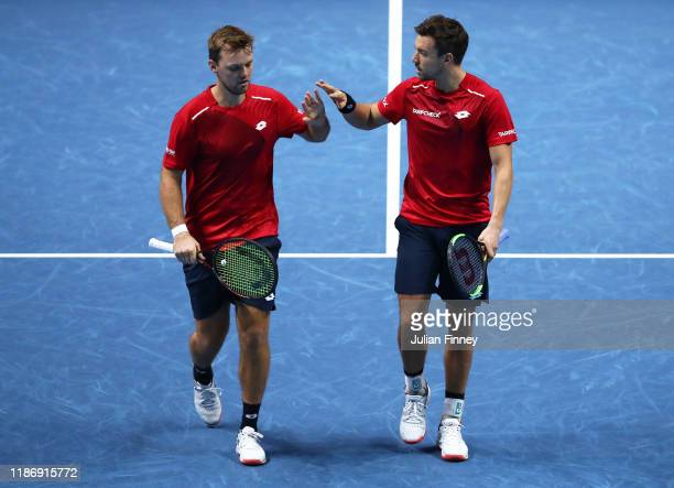 Kevin Krawietz of Germany and Andreas Mies of Germany celebrate in their doubles match against JeanJulien Rojer of The Netherlands and Horia Tecau of...