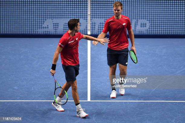 Kevin Krawietz of Germany and Andreas Mies of Germany celebrate in their doubles match against Nicolas Mahut and Pierre-Hugues Herbert of France...