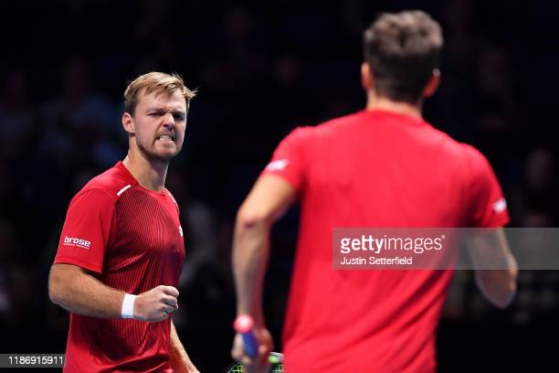 Kevin Krawietz of Germany and Andreas Mies of Germany celebrate winning the first set in their doubles match against JeanJulien Rojer of The...