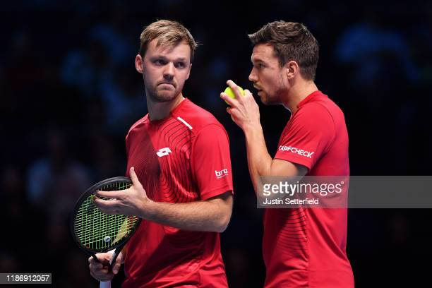 Kevin Krawietz of Germany and Andreas Mies of Germany prepare to serve in their doubles match against JeanJulien Rojer of The Netherlands and Horia...
