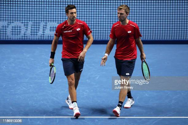 Kevin Krawietz of Germany and Andreas Mies of Germany react in their doubles match against JeanJulien Rojer of The Netherlands and Horia Tecau of...