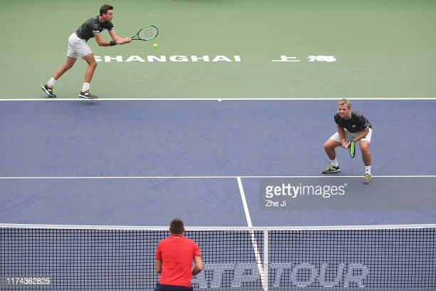 Kevin Krawietz of Germany and Andreas Mies of Germany return a shot during their Men's doubles first round match of 2019 Rolex Shanghai Masters Day 4...
