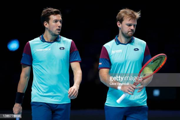Kevin Krawietz of Germany and Andreas Mies of Germany speak to each other during their doubles match against Wesley Koolhof of The Netherlands and...