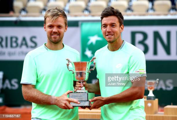 Kevin Krawietz of Germany and partner Andreas Mies of Germany hold the trophy as they celebrate victory during the mens doubles final against Jeremy...