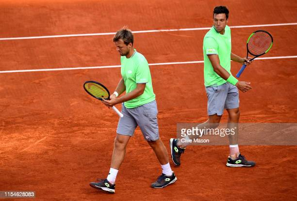 Kevin Krawietz of Germany and partner Andreas Mies of Germany in conversation during the mens doubles final against Jeremy Chardy of France and...
