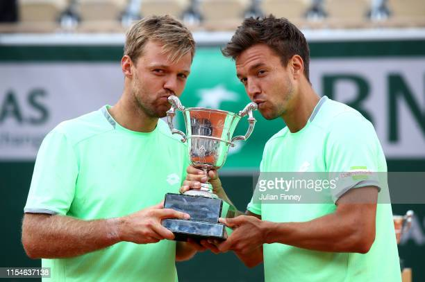 Kevin Krawietz of Germany and partner Andreas Mies of Germany kiss the trophy as they celebrate victory during the mens doubles final against Jeremy...